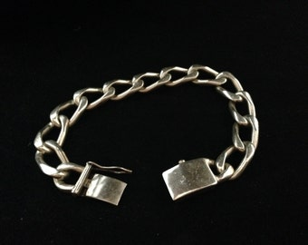 A very large and heavy Sterling silver link bracelet with safety clasp.