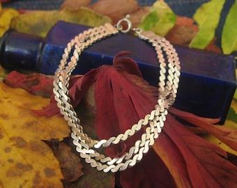 Sterling silver triple strand bracelet