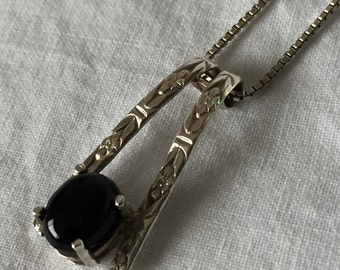 Sterling onyx pendant on silver-tone necklace