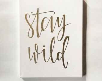 Stay Wild - Canvas | Hand Lettering | Gold | Gold Decor | Nursery Art | Embossed | Gallery Wall | Canvas Art | Arrow | Nursery Decor