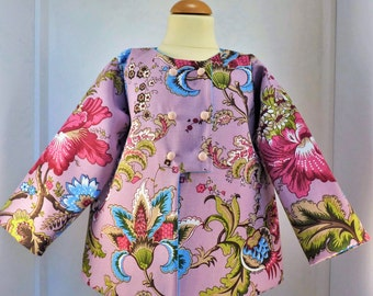 Girl quilted jacket for a 3 years old child in a pink cotton with large multicolored flowers