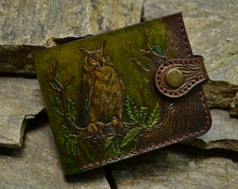 Green leather wallet with the image of a owl