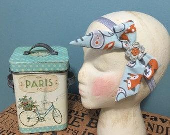 Bow headband with crochet flower