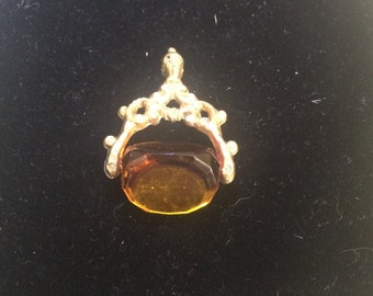 Gold plated watch fob with amber coloured stone