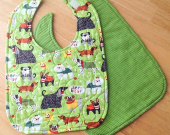 "Quilted baby/toddler bib - green dog print, velcro closure, reversible, 10"" x 13 1/2"""