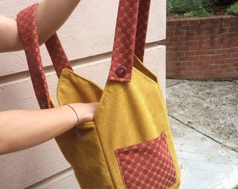 Yellow and red fabric shoulder bag