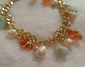 Seafoam in Coral Sea Glass accent in freshwater pearls on a gold charm bracelet