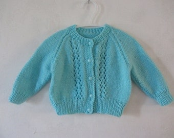 Knitted baby cardigan sweater in turquoise