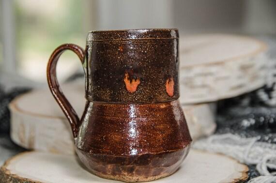 Red mug with orange crystal burst