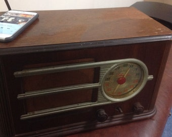 Vintage radio upgraded to play from iphone.