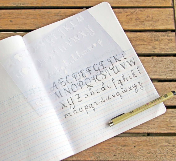 A z calligraphy stencil bullet journal fits by