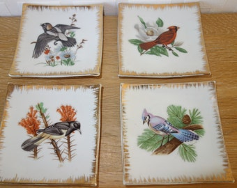 Four little shallow dishes, birds