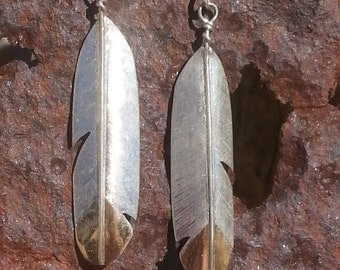 handmade sterling silver with 14k gold tips feather earrings. not casted