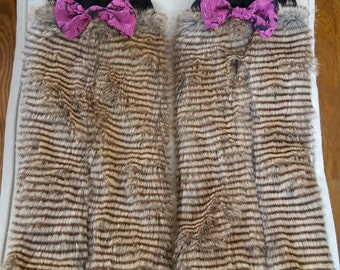 Brown striped furry leg warmers with pink bow