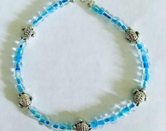 "Beaded turtle bracelet, 7""."