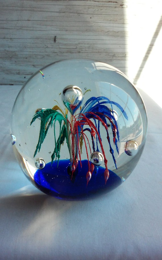 Vintage Art Glass Paperweight.  No manufacturers mark or label.  However,  quite beautiful.  The colors in this one POP like an explosion.