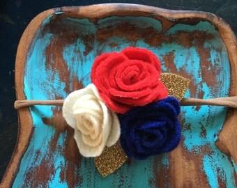 Red, white, and blue felt flower headband on nylon