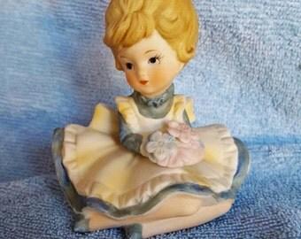 Vintage Porcelain Blonde Little Girl in a Blue Dress