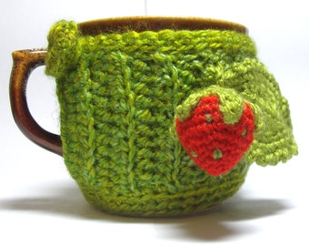 Teacup in the knitted cover