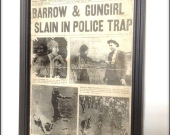 Bonnie and Clyde aged reproduction newspaper cover in frame.