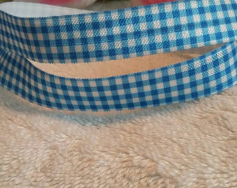 "3 yards, 5/8"" blue and white fold over elastic."