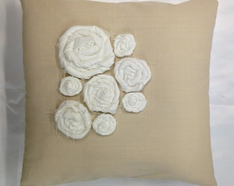 Decorative pillow with handmade flowers