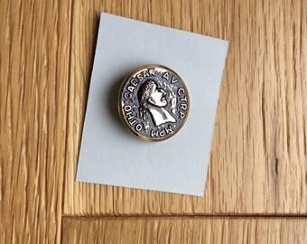 Roman style button