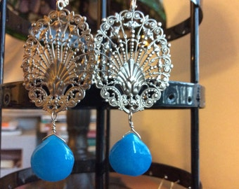 Silver earrings with gemstone drops.