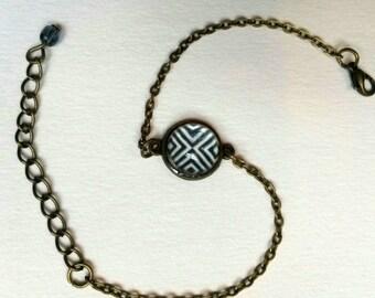 Bracelet cabochon black and white geometric pattern