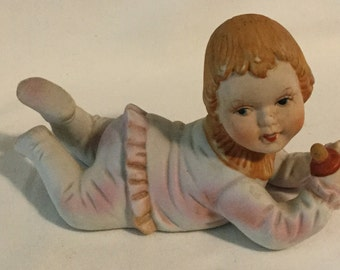 Vintage Porcelain Piano Baby Figurine