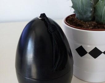 candle made with tadelakt  egg shape in tadelakt  color black