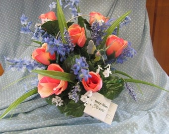 Cute white basdket with blue  and pink flowers