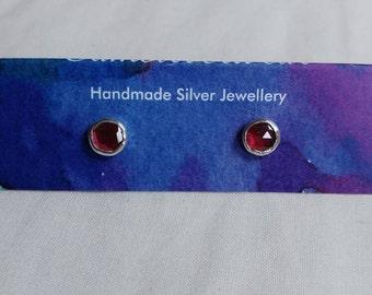 Garnet and silver earrings.