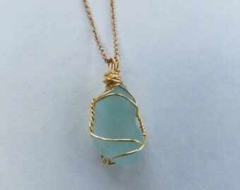 Sea blue wire wrapped sea glass pendant and necklace.