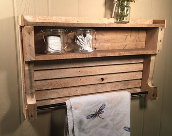 Rustic Towel rack with shelves made from reclaimed wood.