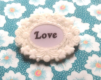 Resin brooch Love (145)