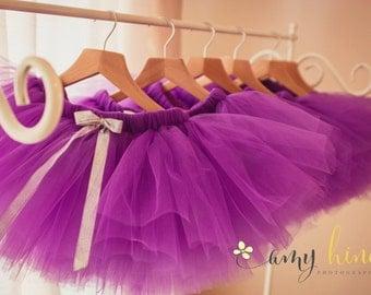 SIX purple tutu skirts. (Party favour)
