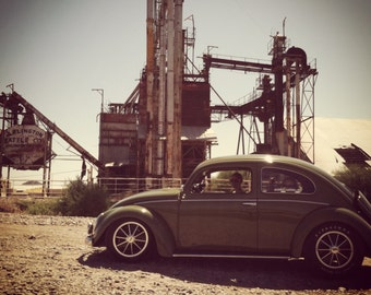 Photograph of Volkswagen and industrial machinery, VW bug, old car picture, old machines, classic car, Volkswagen, vintage, strange photos