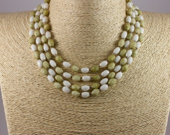 vintage late 1950's four strand hand knotted glass bead necklace