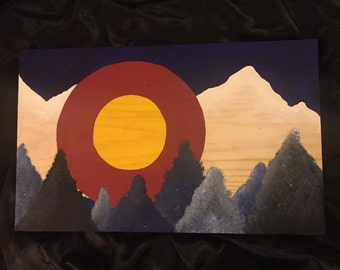 Colorado mountains and flag
