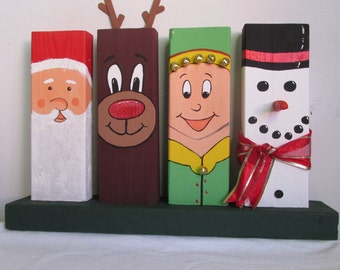 Hand-Painted Wooden 2x4 Christmas Decor, featuring Santa, Rudolph, an Elf, and a Snowman