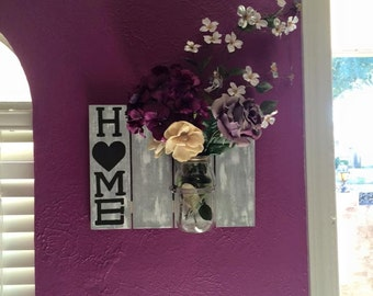 Wooden home sign with mason jar flower vase