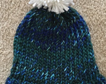 Ready to post hand-knitted turquoise and white beanie