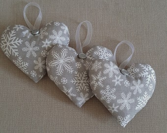 Hanging heart Christmas decoration in grey and white snowflake fabric
