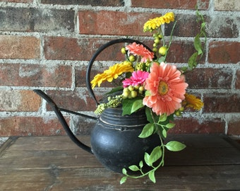 Floral arrangement bronze tea kettle with spring wild flowers and greenery