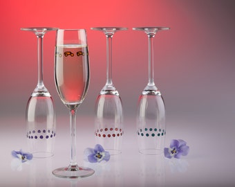 Set of 4 Hand Painted Champagne flutes.  Always be able to spot your glass with these unique, beautifully hand painted champagne flutes