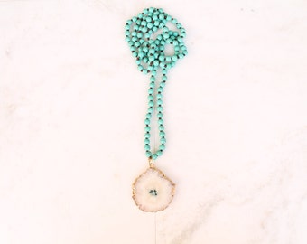 White agate pendant on turquoise howlite hand-knotted necklace