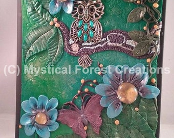 Polymer clay mixed media owl, butterfly and flower journal, in shades of green, pruple blue and yellow...