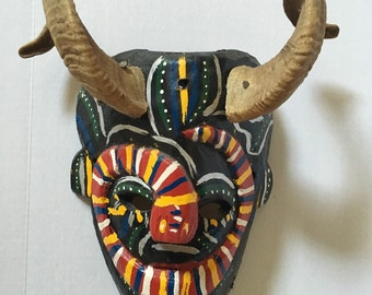 Colorful mask with real antlers