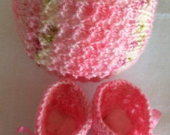 Hand knitted variegated  pink booties and matching hat.